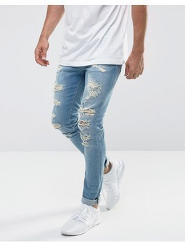 ASOS Super Skinny Jeans In Mid Wash Blue With Extreme Rips - Blue