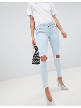 ASOS DESIGN Whitby low rise skinny jeans in philomena light ice stone wash with busted knees - Blue