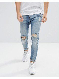 Pull&Bear Ripped Jeans In Carrot Fit In Mid Wash Blue - Blue