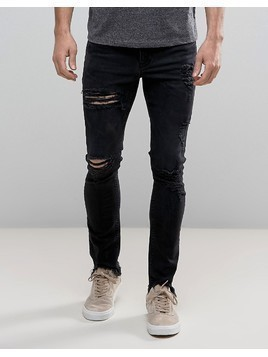 ASOS Super Skinny Jeans In Washed Black With Heavy Rips And Hem Detail - Black