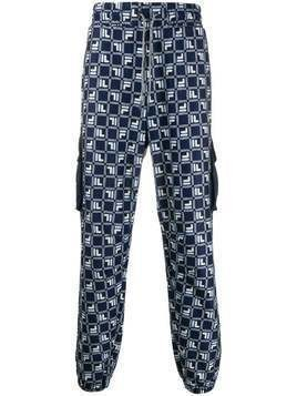 Fila all-over logo print loose fit track pants - Blue