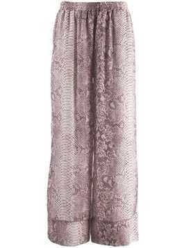 Gold Hawk snakeskin print flared trousers - Pink