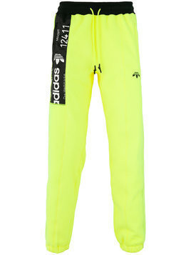 Adidas Originals By Alexander Wang - inside out graphic track pants - unisex - Cotton/Polyester/Spandex/Elastane/Nylon - XXS - Yellow & Orange