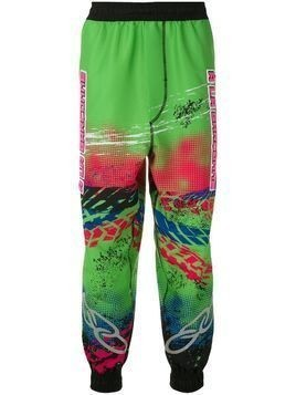 À La Garçonne x OLK Racing printed track trousers - Multicolour
