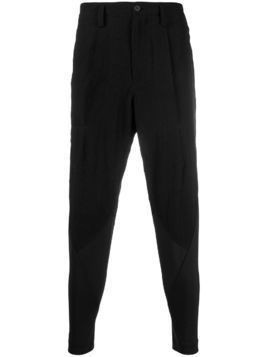 Issey Miyake Men panelled tapered trousers - Black