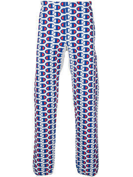 Champion all-over logo print track pants - Blue