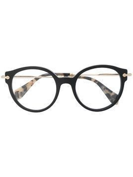 Miu Miu Eyewear round frame tortoise-shell glasses - Red