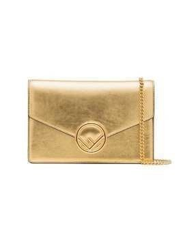 Fendi metallic gold logo leather wallet on a chain bag