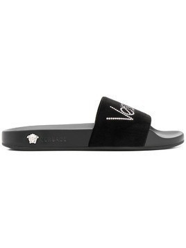 Versace rhinestone logo slide sandals - Black