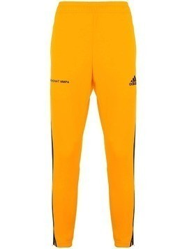 Gosha Rubchinskiy Adidas x Gosha Rubchinskiy side panelled track pants - Yellow & Orange