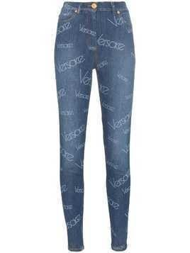 Versace all-over logo print skinny jeans - Blue