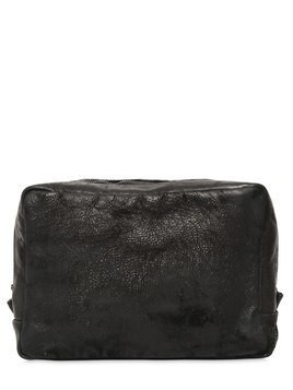 ZIP AROUND EMBOSSED LEATHER TOILETRY BAG