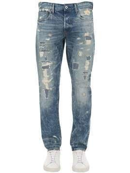 3301 DESTROYED TAPERED DENIM JEANS